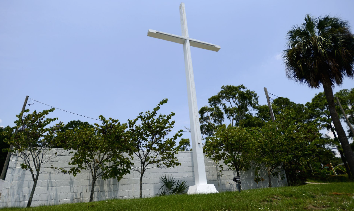 A large white cross in Bayview Park in Pensacola, FL