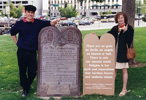 Foundation PR director Dan Barker and Foundation president Anne Gaylor beside the litigated ten Commandments marker in Denver. Next to the marker is Anne\'s suggested wording for a freethought alternative.